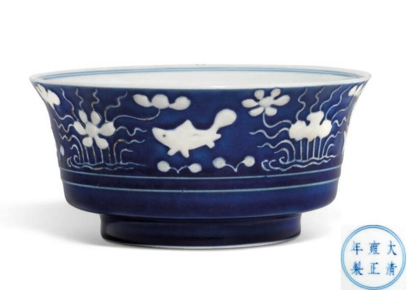 A rare reverse-decorated blue and white 'Fish pond' bowl, Yongzheng six-character mark in underglaze blue within a double blue circle and of the period (1723-1735)