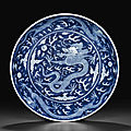 A blue and white reverse-decorated 'dragon' dish, daoguang seal mark in underglaze blue and of the period (1821-1850)