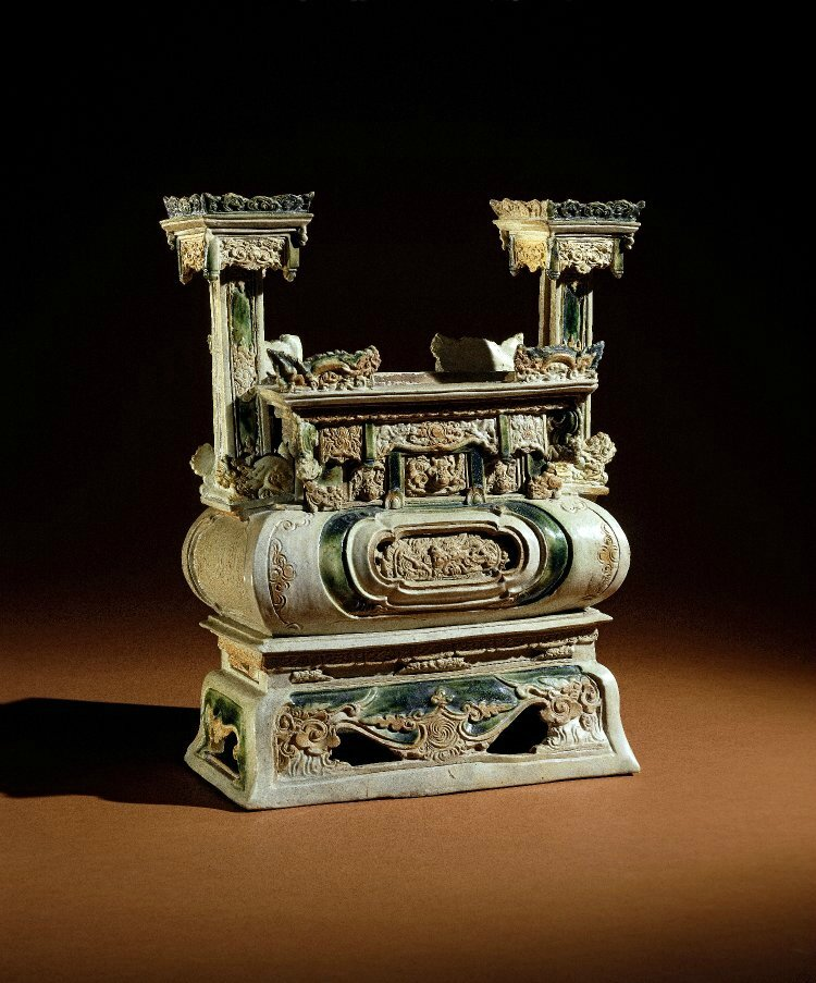 Incense-burner applied with dragons, lions and incised inscription on one end, and square side columns. Made of clear, green glazed stoneware,1575, Vietnam. Height: 39 centimetres. Width: 28.5 centimetres. Purchased from Bluett & Sons. 1985,0125.1. British