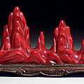 An unusual small red glass mountain-form brush rest