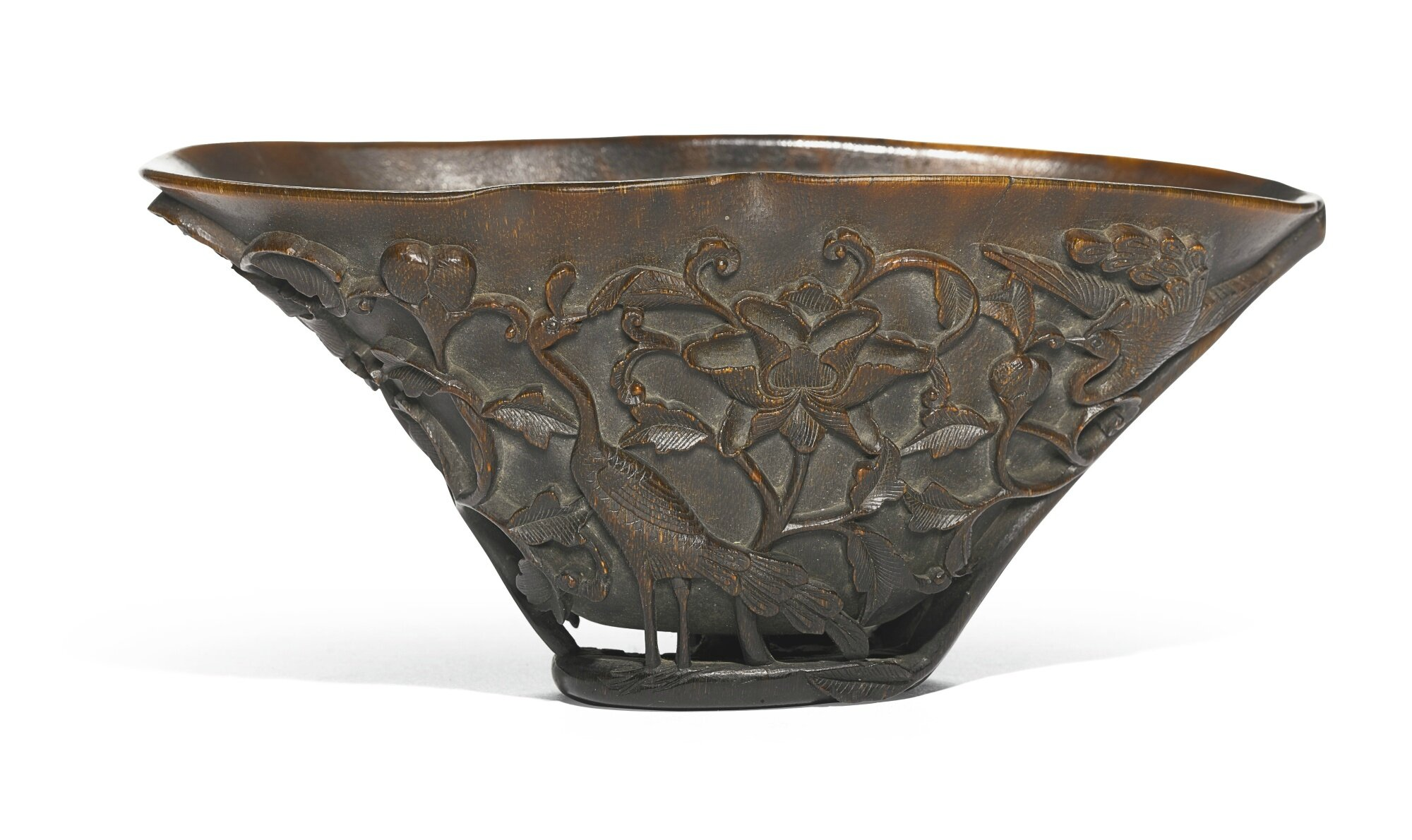 A carved rhinoceros horn libation cup, Qing dynasty, 18th century