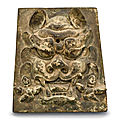A bronze 'lion' plaque, yuan-ming dynasty (1279-1644)