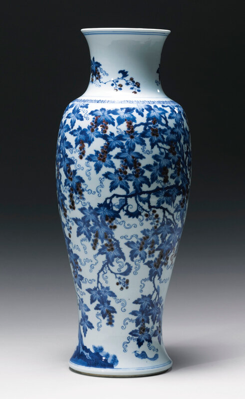 A rare and unusual underglaze-blue and copper-red 'Squirrel and grapevine' vase, Qing dynasty, Kangxi period (1662-1722)
