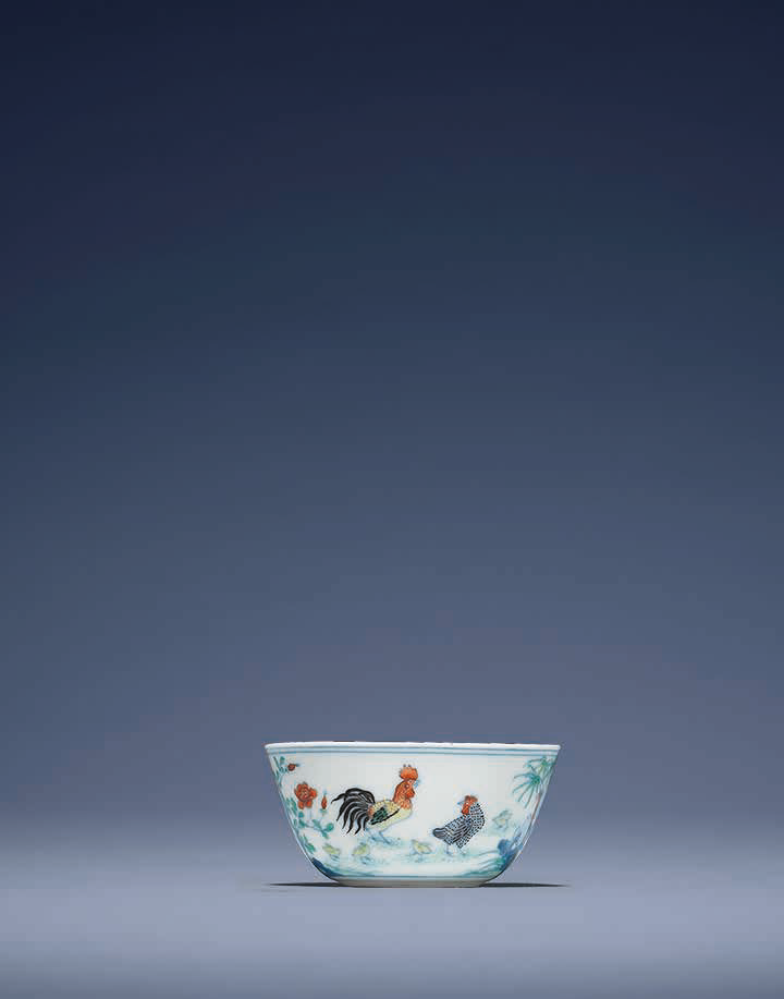 A fine and raredoucai'Chicken' cup, Yongzheng six-character mark in underglaze blue in a double square and of the period (1723-1735)