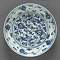 A blue and white porcelain dish with phoenix and floral spray decoration. ming dynasty, 16th/17th century