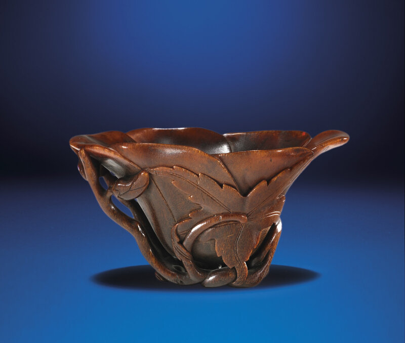 A carved rhinoceros horn floral-form libation cup, Qing dynasty, 18th century