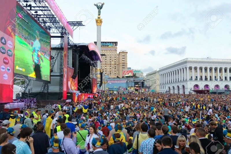 14143536-KIEV-UKRAINE-JUNE-15-Ukrainian-Swedish-and-English-fans-in-the-fanzone-before-match-Euro-2012-betwee-Stock-Photo