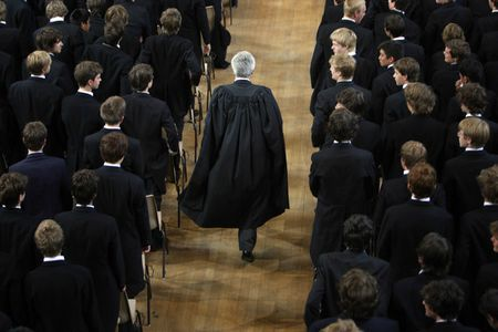 Eton-College-students-stand-as-headmaster-Tony-Little-enters-the-hall