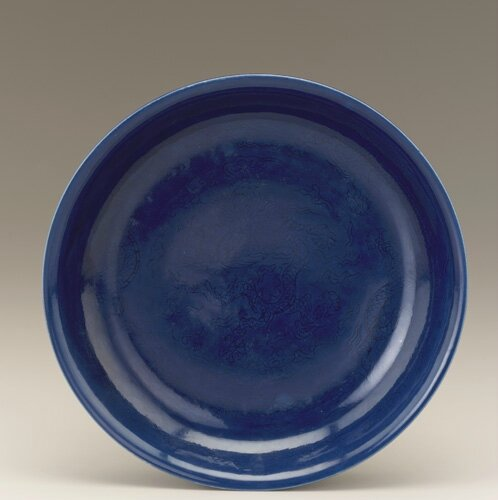 Dish with incised design of dragons, 1522-1566, Ming dynasty, Jiajing reign. Porcelain with cobalt blue glaze. H: 4.5 W: 25.0 cm.Jingdezhen, China. Purchase F1952.3. Freer/Sackler © 2014 Smithsonian Institution