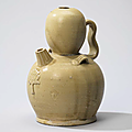 A Changsha straw-glazed pottery ewer, Tang dynasty (618-907)