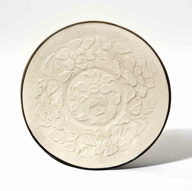A rare molded Ding dish, Northern Song-Jin Dynasty, 12th century