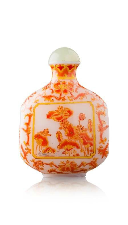 milk glass bottle of flattened square form, with enamelled decoration in orange and yellow of flowering lotus and carp, base with mark in blue enamel, jade stopper. Photo Lyon & Turnbull