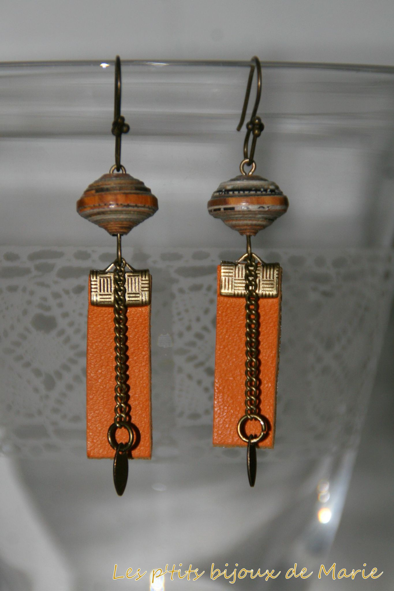 Boucles cuir orange 1