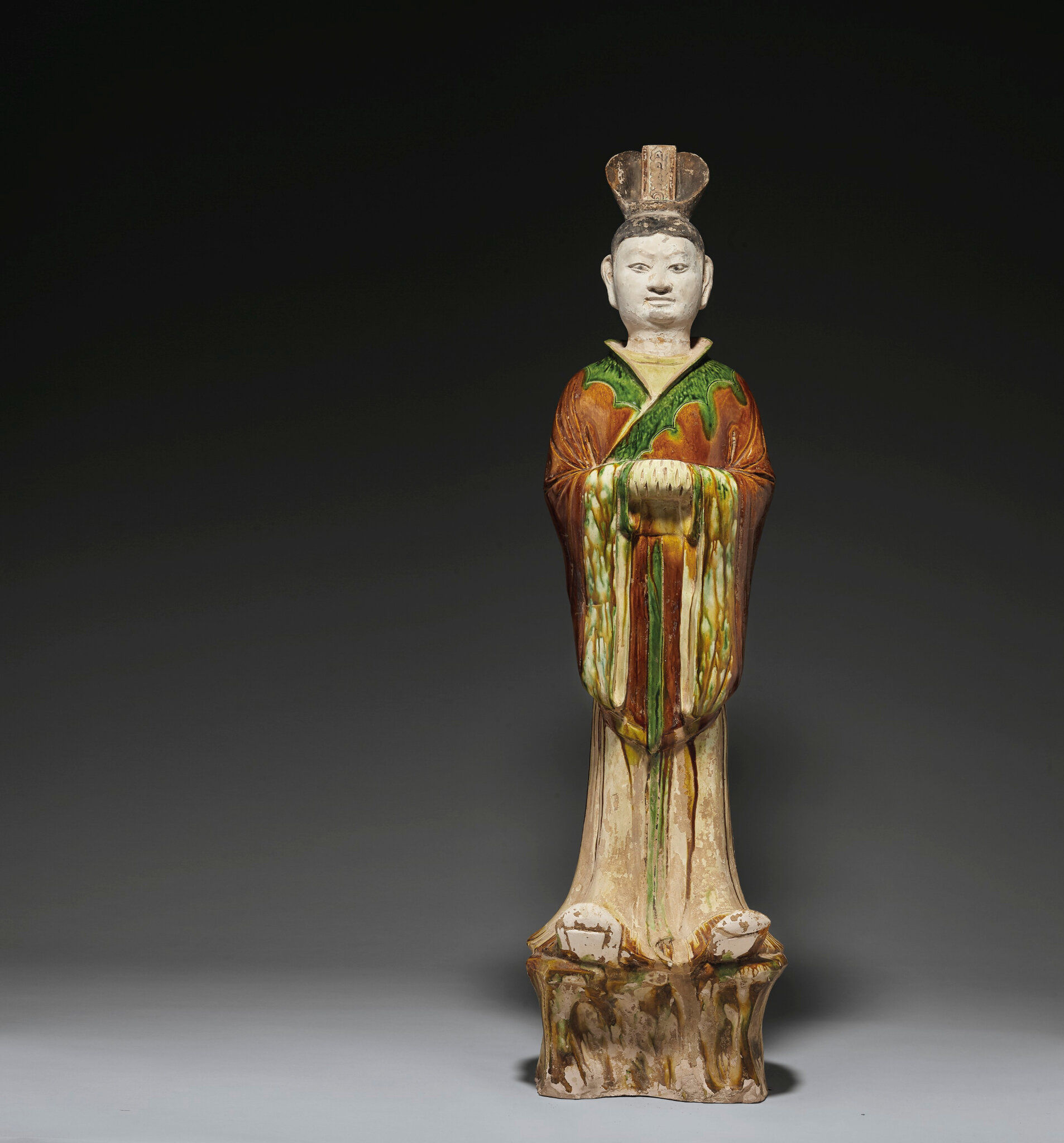 A large sancai-glazed pottery figure of an official, Tang dynasty (618-907)