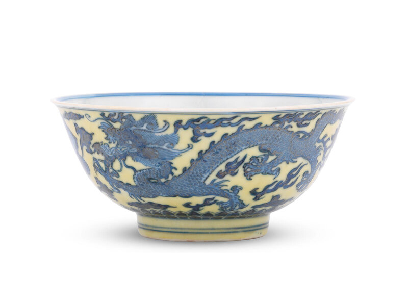 A rare blue and white yellow-enamelled 'dragon' bowl, Kangxi six-character mark and of the period (1662-1722)