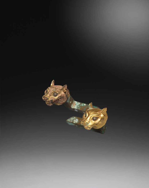 A rare pair of small gilt-bronze tiger-head terminals, Qin dynasty