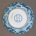 Dish with dragon swimming among the lotus, China, Ming dynasty (1368- 1644), Hongzhi mark and period (1488-1505), Jingdezhen, Jiangxi Province, porcelain with underglaze blue decoration, 4.4 x 21.5 cm. Gift of Florence Marks, Orwell Phillips and Barbara Se