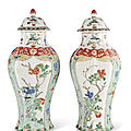 A pair of famille verte octagonal vases and covers, kangxi period (1662-1722)