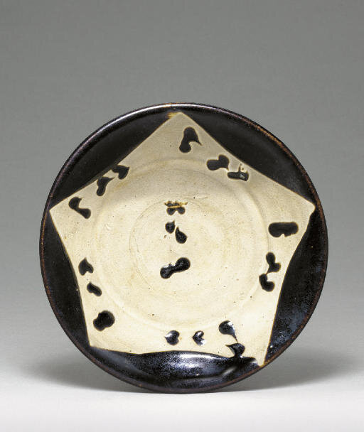 A blackish-brown parcel-glazed stoneware dish, Tang dynasty (618-907)