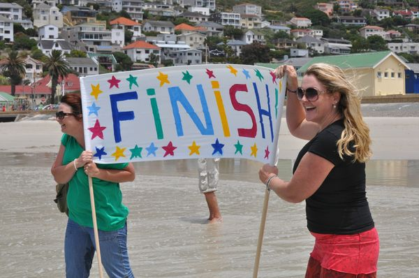 Sylvie and Lisa Ferguson cheering Robert in to shore and home