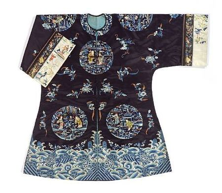 A_woman_s_midnight_blue_silk_overcoat_with_polychrome_figure_embroidery
