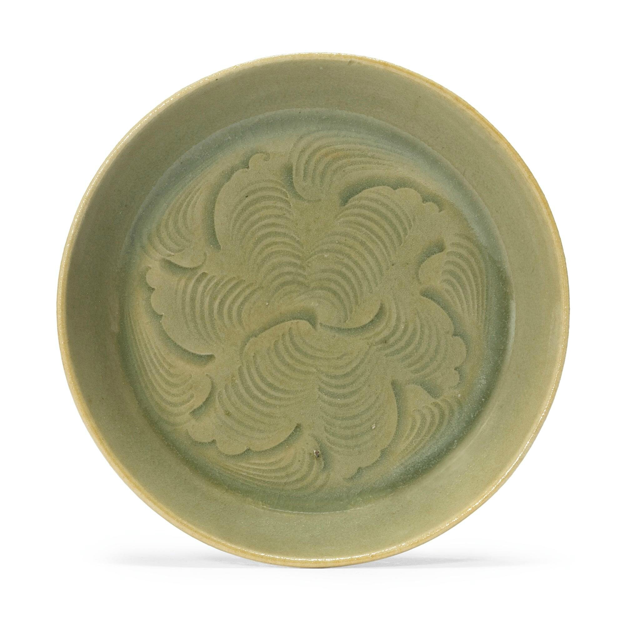 A small carved 'Yaozhou' saucer dish, Northern Song dynasty