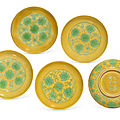 A rare set of five yellow-ground green-enamelled 'lotus' saucer dishes, jiajing six-character incised marks and of the period