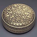A rare miniature parcel-gilt silver circular box and cover, tang dynasty (ad 618-907)