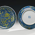A pair of underglaze blue and yellow-enameled 'dragon' dishes, qianlong seal marks and period (1736-1795)