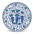 A rimless iznik pottery 'grape' dish, ottoman turkey, circa 1565