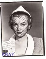 1951-04-12-LoveNest-test_hat-mm-010-1