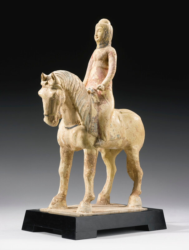 A straw-glazed and cold-painted figure of an equestrienne, Tang dynasty (618-906)