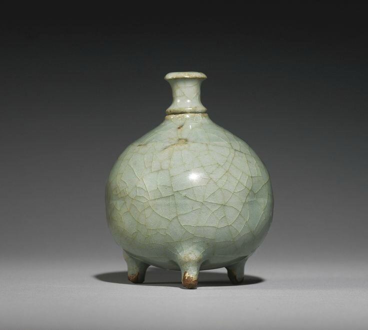 A 'guan'-type, 'Longquan' celadon, waterpot and a stopper, Song Dynasty
