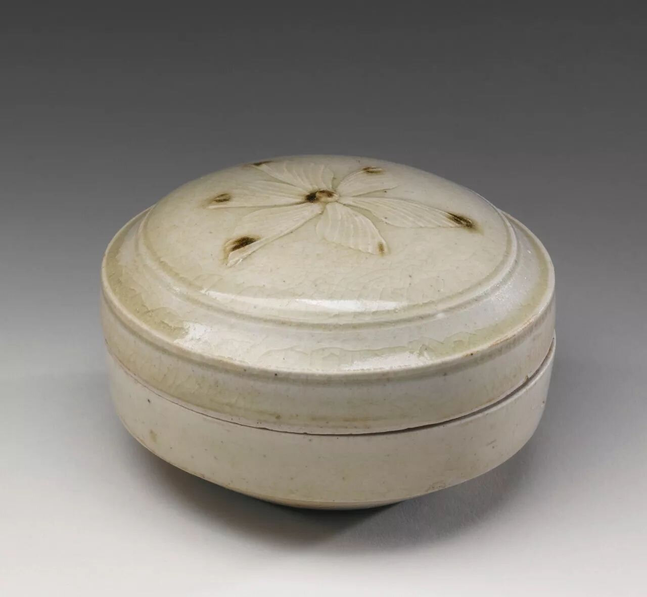 A celadon-glazed small box and cover, Tang dynasty