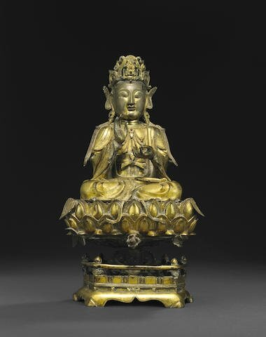 A gilt bronze figure of the Mahasthamaprapta Bodhisattva seated on a lotus throne, Ming dynasty