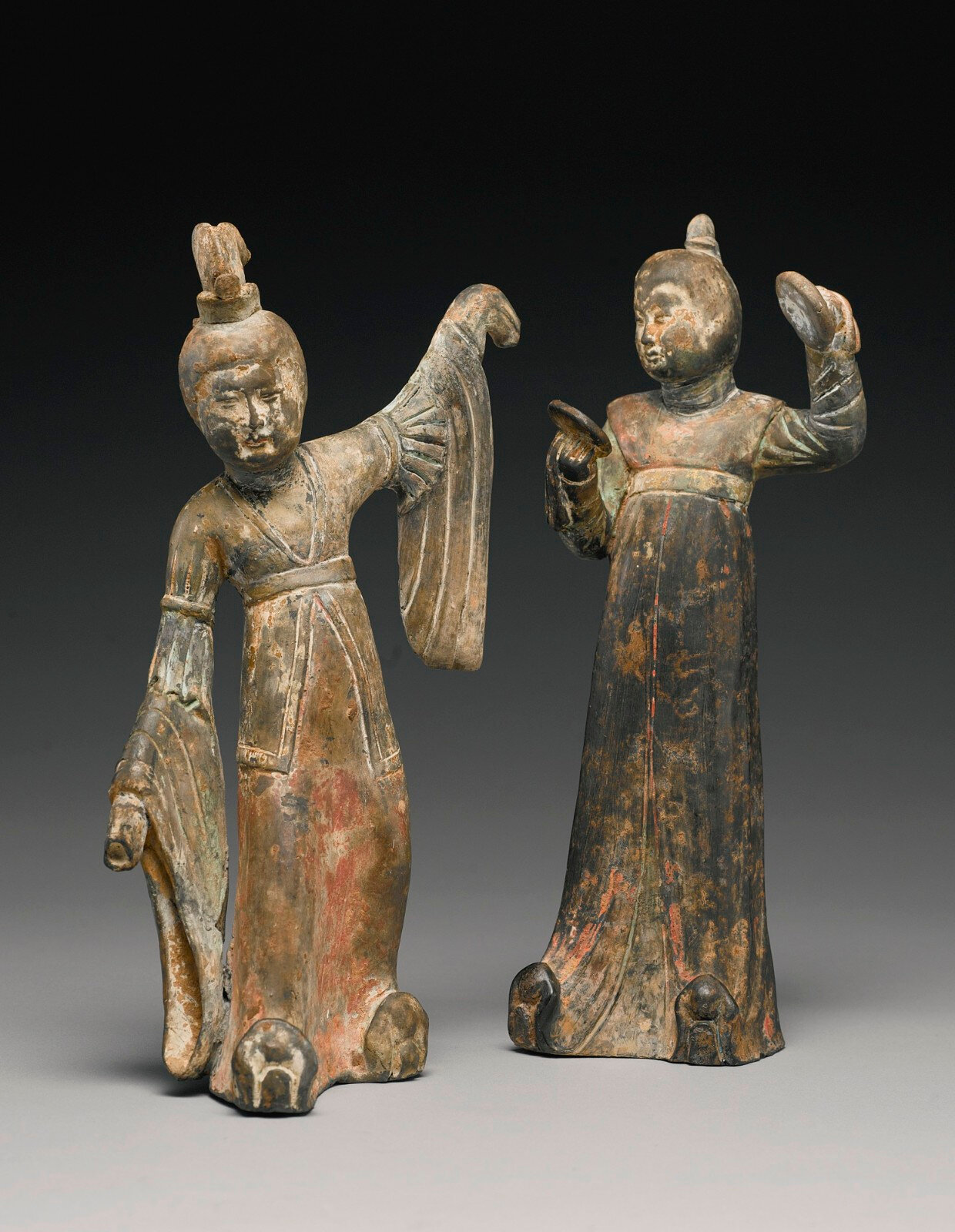 Two painted graypottery figures of female attendants, Early Tang dynasty (618-907)