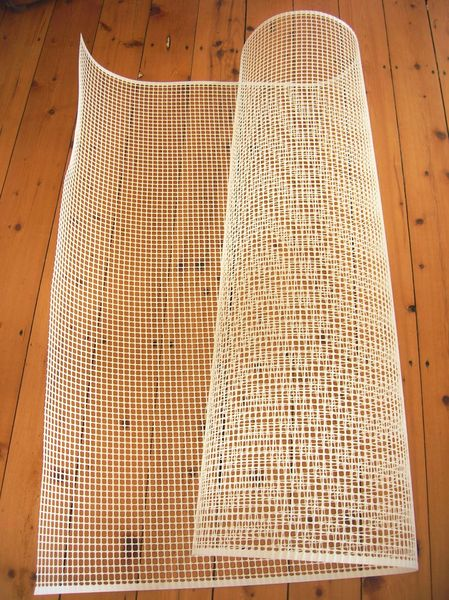 grille tapis pompon