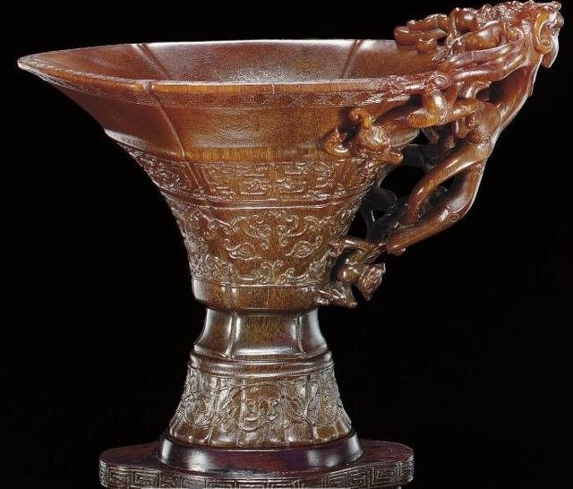 A finely carved archaistic rhinoceros horn libation cup, Ming dynasty, 17th century