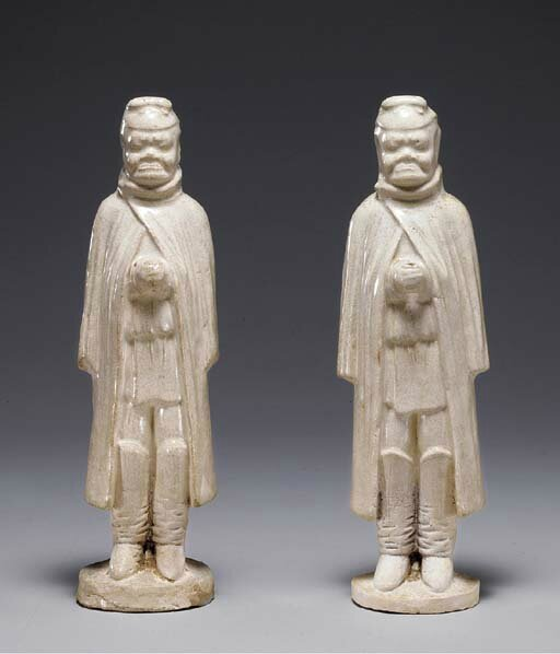 A pair of straw-glazed pottery figures of turko-mongolian attendants, Sui-early Tang dynasty, 6th-7th century