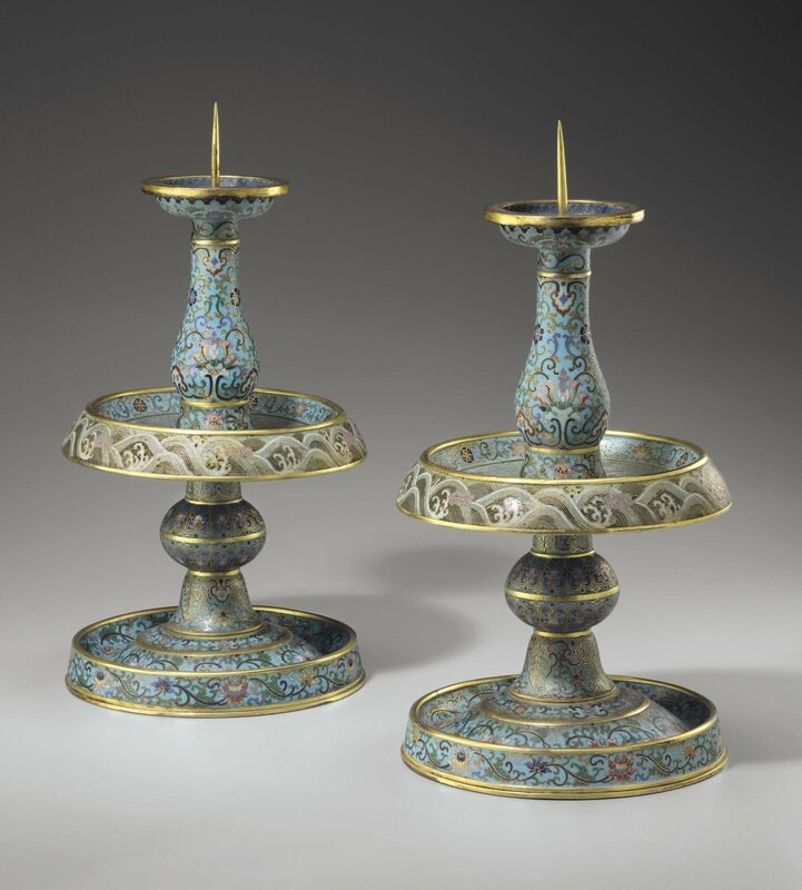 An extremely rare pair of Imperial cloisonné enamel pricket candlesticks, Qianlong incised four-character marks within double squares and of the period (1736-1795)