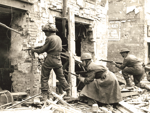 A_Canadian_soldier_fires_on_the_enemy_in_a_house_in_Caen,_July_10,_1944_