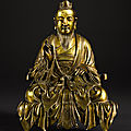 A rare gilt-bronze seated figure of a daoist deity, qing dynasty, 18th century