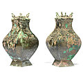 A pair of archaic bronze square vases and covers, fanghu, han dynasty