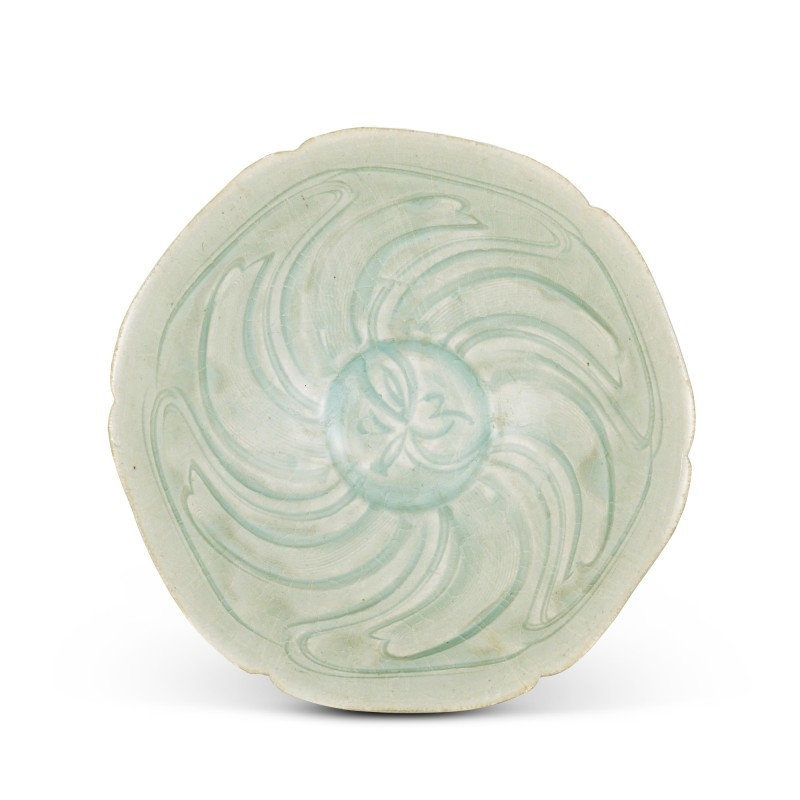 A carved Qingbai 'floral' bowl, Northern Song dynasty (960-1127)