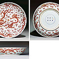 A large iron-red 'dragon' dish, underglaze-blue kangxi six-character mark and of the period (1662-1722)