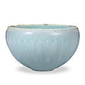 A carved celadon 'lotus' bowl, song dynasty, 960-1279