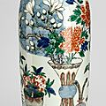 A good wucai 'flowers and antiques' porcelain vase, transitional period