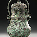 An archaic bronze vessel and cover, you, western zhou dynasty, 11th-10th century bc