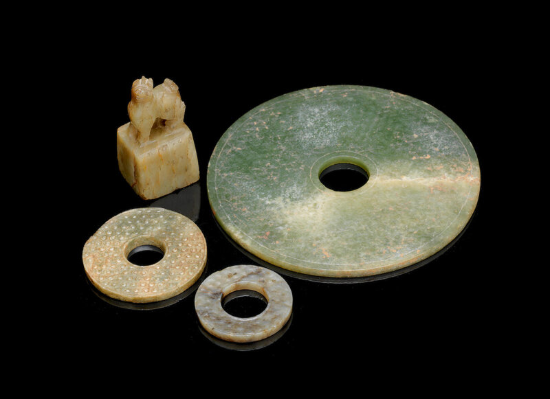 Three green and russet jade bi discs, Han Dynasty or later