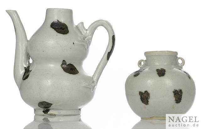 A Yingqing double-gourd iron-spot splashed ewer and a small jarlet, China, Song dynasty